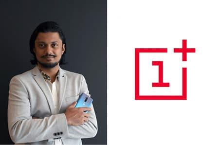 Siddhant Narayan holding OnePlus 8T